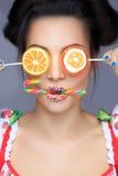 Beautiful pin-up girl holding sweet lollipop Royalty Free Stock Image