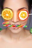 Beautiful pin-up girl holding sweet lollipop Stock Photos