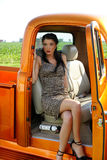 Beautiful pin-up girl inside vintage truck Royalty Free Stock Photo
