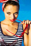 Beautiful pin up girl near the swimming pool Stock Images