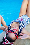 Beautiful pin up girl near the swimming pool Stock Photography