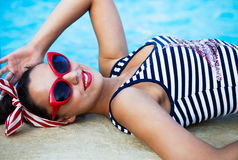 Beautiful pin up girl near the swimming pool Stock Image