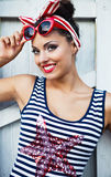 Beautiful pin up girl near the white wall Stock Images