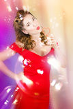 Beautiful pin-up girl at retro disco dance party Stock Images