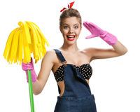 Beautiful pin-up girl wearing pink rubber protective gloves holding cleaning mop Royalty Free Stock Images