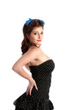 Beautiful pin-up style model posing over white background Royalty Free Stock Photo