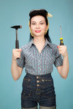Beautiful pin up woman with hammer and screwdriver Royalty Free Stock Photography