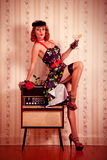 Beautiful pin-up woman with martini Stock Photography