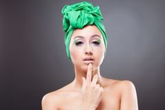 Beautiful pin-up woman point at her lips Royalty Free Stock Photography