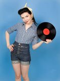 Beautiful pin-up woman with record in her hands Royalty Free Stock Photos