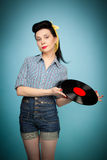 Beautiful pin-up woman with record in her hands Royalty Free Stock Images