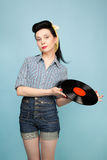 Beautiful pin-up woman with record in her hands Stock Photography