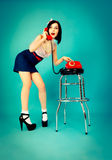 Beautiful pin up woman with telephone Stock Photography