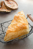 Beautiful pineapple pie in a basket. Breakfast in the morning Stock Photos