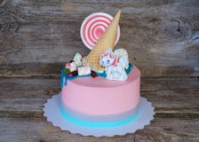 Beautiful pink baby cake with candy and marshmallow stock photos