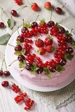 Beautiful pink berry cake on a plate closeup. vertical top view Royalty Free Stock Photos