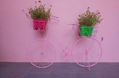 Beautiful Pink bike Wall of pink background.  stock photography