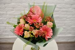 Beautiful pink bouquet with gerberas and roses stock photos