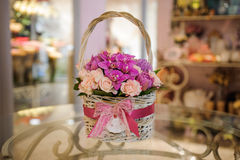 Beautiful pink bouquet of mixed flowers in basket on table. Beautiful pink bouquet of mixed flowers in basket on glass table Royalty Free Stock Photo