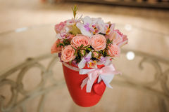 Beautiful pink bouquet of mixed flowers in basket on table. Beautiful pink bouquet of mixed flowers in basket on glass table Stock Image