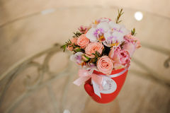 Beautiful pink bouquet of mixed flowers in basket on table. Beautiful pink bouquet of mixed flowers in basket on glass table Stock Photography
