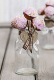 Beautiful pink cake pops decorated with sprinkles Royalty Free Stock Photo