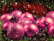 Beautiful pink Christams balls and spruce needles Royalty Free Stock Images