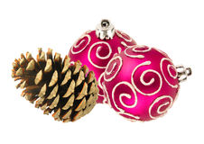 Beautiful pink Christmas balls and pine cone isolated on white Royalty Free Stock Image