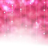 Beautiful pink dangle garlands background with copy space Stock Photos