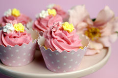 Beautiful pink decorated cupcakes on pink cake stand - Close up with bokeh.