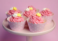 Beautiful pink decorated cupcakes on pink cake stand in star cups. Royalty Free Stock Photos