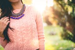 Beautiful Pink Fashion Girl. Beautiful fashion girl with the sun in the back stock images