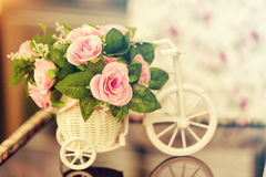 Beautiful pink flowers on the small bicycle model Royalty Free Stock Photos