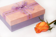 Beautiful pink gift box with bow and orange rose Royalty Free Stock Photography