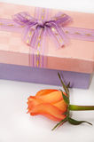 Beautiful pink gift box with bow and orange rose Stock Photography