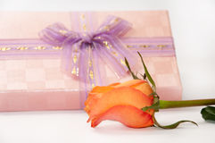 Beautiful pink gift box with bow and orange rose Royalty Free Stock Image