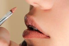 Beautiful pink gloss on lips Stock Photography