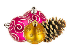 Beautiful pink and golden Christmas balls and pine cone isolated Royalty Free Stock Photography