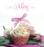 Beautiful pink heart or Mothers Day theme cupcake with seasonal flowers and decorations for the month of May. With sample text or copy space for your text here Stock Image