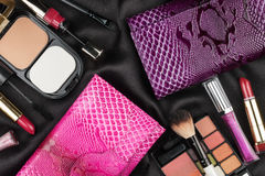 Beautiful pink and lilac bags among cosmetics Stock Images