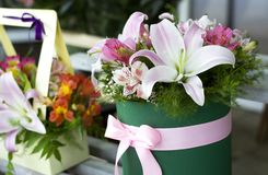 Beautiful pink lilies in a gift box. Bouquet of flowers with lilies. stock photography