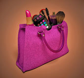 Beautiful pink makeup bag and cosmetics  on white Royalty Free Stock Image