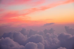 Beautiful pink and orange clouds at dawn morning sunlight. View from the plane Royalty Free Stock Images