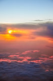 Beautiful pink and orange clouds at dawn morning sunlight. View from the plane Stock Photos