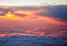 Beautiful pink and orange clouds at dawn morning sunlight. View from the plane Royalty Free Stock Photo