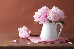 Beautiful pink peony bouquet in vase Stock Photo