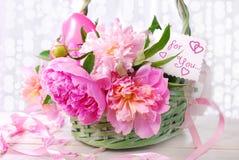 Beautiful pink peony in wicker basket Royalty Free Stock Image