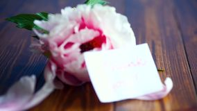 Beautiful pink peony. On a wooden table