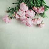 Beautiful pink, rose peonies on wood plate. Can be used as background Stock Photo