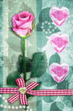 Beautiful pink rose with pink hearts. Stock Photography
